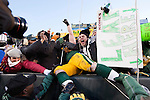 Green Bay Packers fans celebrate as full back John Kuhn (30) does a Lambeau Leap after scoring a touchdown during an NFL divisional playoff football game against the New York Giants on January 15, 2012 in Green Bay, Wisconsin. The Giants won 37-20. (AP Photo/David Stluka)