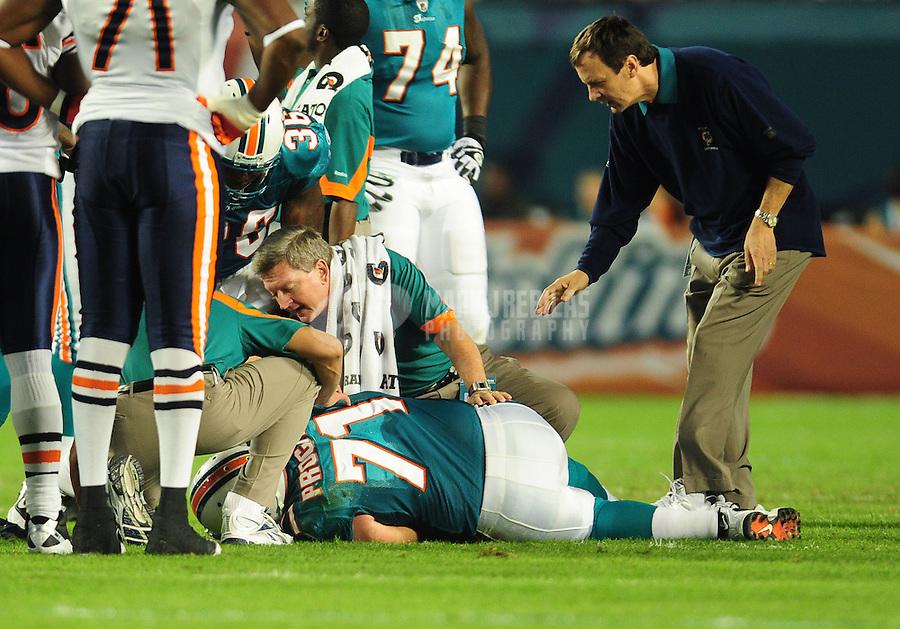Nov. 18, 2010;  Miami, FL, USA; Miami Dolphins guard (71) Cory Procter lays on the field injured against the Chicago Bears at Sun Life Stadium. Mandatory Credit: Mark J. Rebilas-