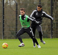 SWANSEA, WALES - JANUARY 28: (L-R) Henry Jones against Kyle Naughton during the Swansea City Training Session on January 28, 2016 in Swansea, Wales.