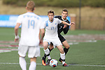 SALEM, VA - DECEMBER 3:Kevin Lawson (13) and Matt Hinds (7) battle for the ball during theDivision III Men's Soccer Championship held at Kerr Stadium on December 3, 2016 in Salem, Virginia. Tufts defeated Calvin 1-0 for the national title. (Photo by Kelsey Grant/NCAA Photos)