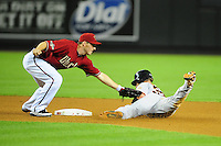 Jun. 15, 2011; Phoenix, AZ, USA; Arizona Diamondbacks shortstop Stephen Drew tags out San Francisco Giants base runner Aaron Rowand in the seventh inning at Chase Field. Mandatory Credit: Mark J. Rebilas-