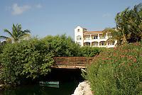 Canoe under bridge at Hacienda Tres Rios, an eco-luxury resort on the Riviera Maya, Quintana Roo, Mexico.