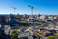 """High-rise construction cranes along interstate 35 (IH-35) fill the downtown Austin Skyline. Downtown Austin's Construction Boom is the fastest growing in the country. Dozens of downtown Austin hotel, office, retail and residential projects are underway or about to begin, spurred by an """"influx of young and highly educated workers"""" and the arrival of tech companies including Apple, Microsoft, Facebook, Google, Twitter, Instagram, Oracle and Cirrus Logic."""