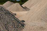 Piles of variously textured gravel make an interesting contrast in a limestone quarry near Meaford, Ontario.
