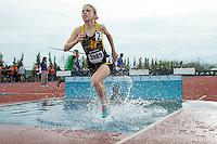 Lutheran South freshman Riley Schelp runs out of the water pit during the 2000-meter steeplechase at the 2015 Kansas Relays where she finished 2nd in 7:32.83.