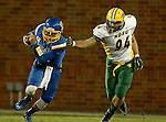 BROOKINGS, SD - OCTOBER 3:  Zach Lujan #16 from South Dakota State slips the grasp of Stanley Jones #94 from North Dakota State in the second quarter of their game Saturday night at Coughlin Alumni Stadium in Brookings. (Photo by Dave Eggen/Inertia)