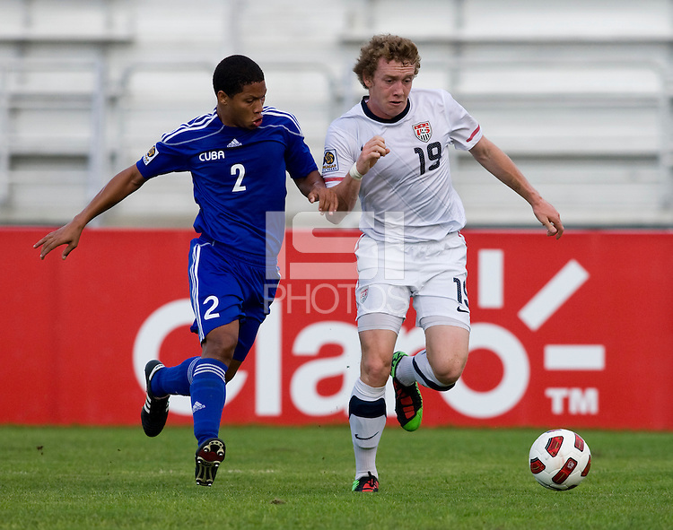Jack McBean (19) of the United States tries to get past Alejandro Cala (2) of Cuba  during the first day of the group stage at the CONCACAF Men's Under 17 Championship at Catherine Hall Stadium in Montego Bay, Jamaica. The United States defeated Cuba, 3-1.