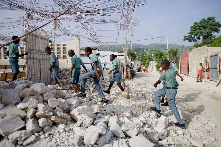 School children walk through what remains of their local church nearly 6 months after January's devastating earthquake in the neighborhood of Aztec, Carrefour, Port-Au-Prince,  July 05, 2010.  (Natasha Fillion/CARE)