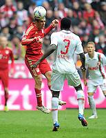 FUSSBALL   1. BUNDESLIGA  SAISON 2011/2012   29. Spieltag FC Bayern Muenchen - FC Augsburg       07.04.2012 Philipp Lahm (li, FC Bayern Muenchen) gegen Gibril Sankoh (FC Augsburg)