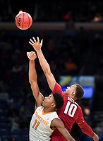 NWA Democrat-Gazette/CHARLIE KAIJO Arkansas Razorbacks forward Daniel Gafford (10) tips off the ball with Tennessee Volunteers forward Kyle Alexander (11)  during the Southeastern Conference Men's Basketball Tournament semifinals, Saturday, March 10, 2018 at Scottrade Center in St. Louis, Mo. The Tennessee Volunteers knocked off the Arkansas Razorbacks 84-66