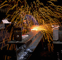 Welder,working on steel girder.