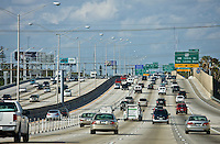 Traffic on the highway heading out of Miami at Opa Locka Boulevard, Florida, United States of America