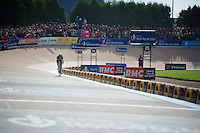 Niki Terpstra (NLD/OPQS) has 1 more lap to go and looks across to see if his rivals have already entered the velodrome <br /> <br /> Paris-Roubaix 2014