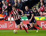 Chris Basham of Sheffield Utd and Dan Gosling of Bournemouth during the Premier League match at Bramall Lane, Sheffield. Picture date: 9th February 2020. Picture credit should read: Simon Bellis/Sportimage