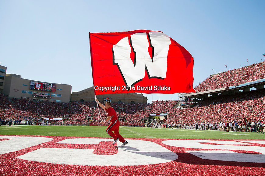Wisconsin Badgers cheerleader carries the flag across the endzone after a touchdown during an NCAA college football game against the Georgia State Panthers Saturday, September 17, 2016, in Madison, Wis. The Badgers won 23-17. (Photo by David Stluka)