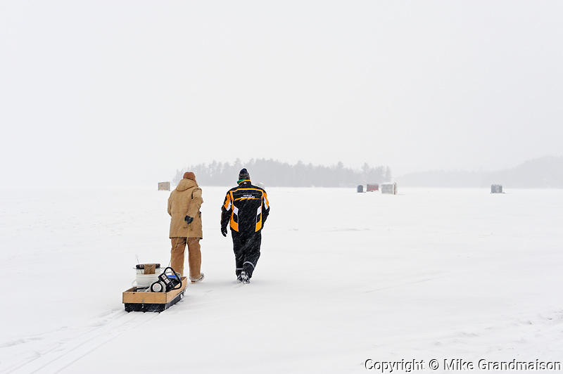 Walking across Lake of Bays to do some ice fishing<br />