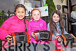 Dromtrasna musicians Lily Reynolds, Meave Finnerty and Caoimhe Scannell busking in Abbeyfeale last Friday evening for the annual fleadh.