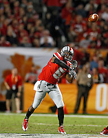 Ohio State Buckeyes quarterback Braxton Miller (5) throws to a receiver in the 1st quarter of their game against Clemson Tigers in the Discover Orange Bowl at Sun Life Stadium in Miami Gardens, Florida on January 3, 2014.(Dispatch photo by Kyle Robertson)