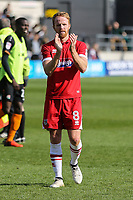 Grimsby Town goalscorer Craig Disley applauds the travelling fans after the Sky Bet League 2 match between Barnet and Grimsby Town at The Hive, London, England on 29 April 2017. Photo by David Horn.
