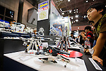 Visitors look at action figures of the fiction mecha anime Macross at the 56th All Japan Model & Hobby Show in Tokyo Big Sight on September 25, 2016. The exhibition introduced hobby goods such as plastic models, action figures, drones, and airsoft guns. (Photo by Rodrigo Reyes Marin/AFLO)