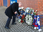 Memorial to the victims of the Ibrox disaster of 1971 at the John Greig Statue, Ibrox Stadium:<br /> Colin Stein lays a wreath on behalf of the Club