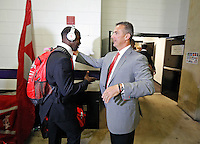 Ohio State Buckeyes head coach Urban Meyer and Ohio State Buckeyes quarterback J.T. Barrett (16) shake hands after arriving at M&T Bank Stadium for their game against Navy in Baltimore, Maryland on August 30, 2014. (Dispatch photo by Kyle Robertson)