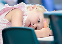 NWA Democrat-Gazette/CHARLIE KAIJO Audrey Zuercher, 4, of Rogers concentrates on a collage during a collage making art session, Monday, September 9, 2019 at the Rogers Public Library in Rogers.<br /> <br /> The program is geared towards kids ages 5-12 inspired by the work of illustrator Eric Carle. Kids use a variety of materials like paint, scissors, glue, pom-poms, gems, marbles, geometric shapes, magazine cut-outs, markers and puzzle pieces to illustrate a weekly theme.