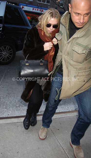 WWW.ACEPIXS.COM . . . . .  ....December 18 2011, New York City....Actress Ashley Olsen is wisked into her downtown hotel by her bodyguard on December 18 2011 in New York City....Please byline: PHILIP VAUGHAN - ACE PICTURES.... *** ***..Ace Pictures, Inc:  ..Philip Vaughan (212) 243-8787 or (646) 679 0430..e-mail: info@acepixs.com..web: http://www.acepixs.com