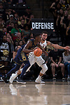 Mitchell Wilbekin (10) of the Wake Forest Demon Deacons guards TJ Gibbs (10) of the Notre Dame Fighting Irish during second half action at the LJVM Coliseum on February 24, 2018 in Winston-Salem, North Carolina. The Fighting Irish defeated the Demon Deacons 76-71.  (Brian Westerholt/Sports On Film)