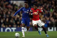 30th October 2019; Stamford Bridge, London, England; English Football League Cup, Carabao Cup, Chelsea Football Club versus Manchester United; Fred of Manchester Utd competes for the ball with Callum Hudson-Odoi of Chelsea - Strictly Editorial Use Only. No use with unauthorized audio, video, data, fixture lists, club/league logos or 'live' services. Online in-match use limited to 120 images, no video emulation. No use in betting, games or single club/league/player publications