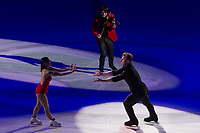 Elena Jovanovich (L) and Nodar Maisuradze (R) perform with Emmy-award winning violin player-composer musician Edvin Marton (top) of Hungary perform during the Kings on Ice skating show in Budapest, Hungary on April 29, 2018. ATTILA VOLGYI