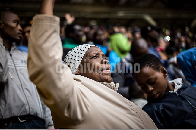 People mourn their death leader Nelson Mandela in Johannesburg, South Africa