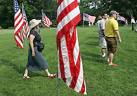 Spectators walk amoung American flags during the 45th annual Independence Day Celebration and Naturalization Ceremony held Wednesday July 4, 2007 at Monticello in Charlottesville, VA. Photo/Andrew Shurtleff