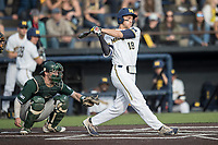 Michigan Wolverines first baseman Jake Bivens (18) follows through on his swing against the Michigan State Spartans during the NCAA baseball game on April 18, 2017 at Ray Fisher Stadium in Ann Arbor, Michigan. Michigan defeated Michigan State 12-4. (Andrew Woolley/Four Seam Images)
