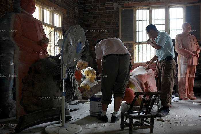 """Workers craft a statue of Mao Zedong out of resin at the workshop of a """"Red"""" memorabilia collector and manufacturer, near Mao's birthplace in Shaoshan, Hunan Province, China on 12 August 2009.  The workers were once electricians.The village of Shaoshan, in rural Hunan Province, is tiny in size but big in name. It was the childhood home for Mao Zedong, the controversial revolutionary who came from obscurity but eventually defied all odds conquered China in the name of communism. Now his home, a sacred place among China's official propaganda, is in reality a microcosm of the country itself: part commercialism, part superstition, with a dash of communist ideological flavor."""