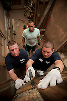 110524-N-DR144-074 HONG KONG (May 24, 2011) Gunner's Mate 1st Class David Hurtado, right, and Logistics Specialist 1st Class Jeremy Bernier, left, both assigned to Nimitz-class aircraft carrier USS Carl Vinson (CVN 70), repair a wall at the distribution center for the Crossroads Foundation, a Hong Kong-based non-profit organization specializing in global distribution of excess goods to impoverished communities.  Nineteen Carl Vinson Sailors participated in a community service project to assist with upkeep and maintenance at the 14-acre facility. Carl Vinson and Carrier Air Wing (CVW) 17 are underway in the U.S. 7th Fleet area of responsibility. (U.S. Navy photo by Mass Communication Specialist 2nd Class James R. Evans / Released)