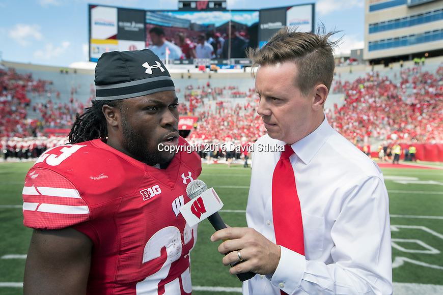 Wisconsin Badgers running back Dare Ogunbowale (23) talks to UWBadgers.com Chris Hall during an NCAA college football game against the Georgia State Panthers Saturday, September 17, 2016, in Madison, Wis. The Badgers won 23-17. (Photo by David Stluka)