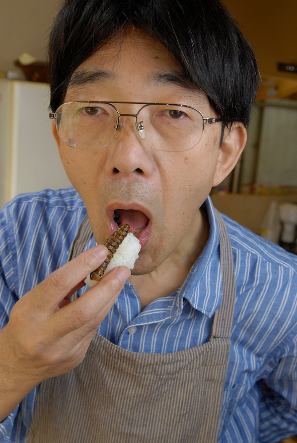 "Shoichi Uchiyama eating privet-hawk moth larva sushi.  Tokyo resident Shoichi Uchiyama is the author of ""Fun Insect Cooking"". His blog on the topic gets 400 hits a day. He believes insects could one day be the solution to food shortages, and that rearing bugs at home could dispel food safety worries."