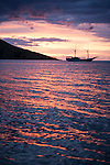 Rakiraki, Viti Levu, Fiji; the Fiji Siren liveaboard dive boat at sunset, anchored in front of the Volivoli Beach Resort
