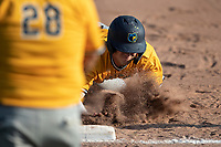 Garrett Shultz (25) of the Kalamazoo Growlers dives back to first base against the Battle Creek Bombers during Northwoods League action at Homer Stryker Field on July 2nd, 2020 in Kalamazoo, Michigan. Shultz plays college baseball at Xavier University. The Bombers defeated the Growlers 4-1. (Andrew Woolley/Four Seam Images)