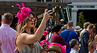 LOUISVILLE, KY - MAY 04: A woman takes a photo while wearing a fancy pink fascinator on Kentucky Oaks Day at Churchill Downs on May 4, 2018 in Louisville, Kentucky. (Photo by Eric Patterson/Eclipse Sportswire/Getty Images)