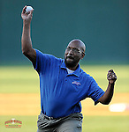 New Byrnes High School football coach Brian Lane throws out the first pitch in a game between the Wade Hampton Generals and the Byrnes Rebels on Wednesday, April 23, 2014, at Fluor Field at the West End in Greenville, South Carolina. (Tom Priddy/Four Seam Images)