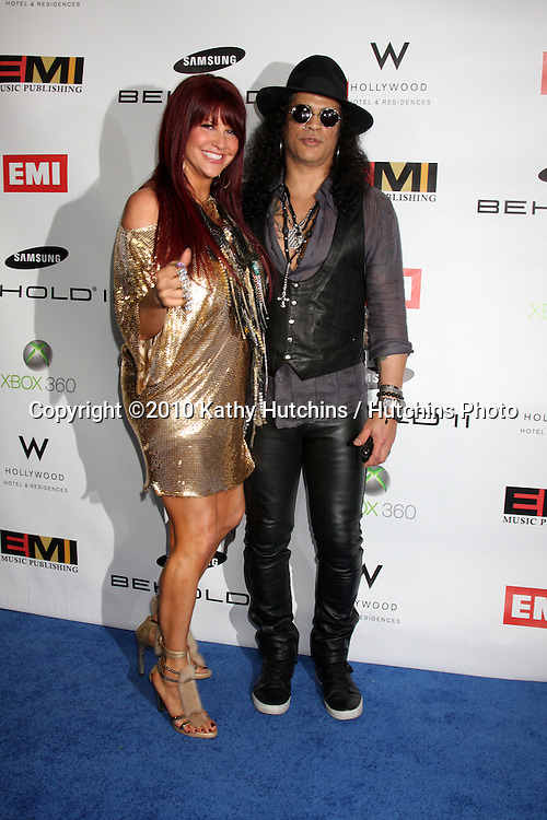 Slash & Perla Hudson.arriving at the EMI Post Grammy Party 2010.W Hotel Hollwood.Los Angeles, CA.January 31, 2010.©2010 Kathy Hutchins / Hutchins Photo....