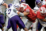 MADISON, WI - SEPTEMBER 9: Defensive lineman Nick Hayden #96 of the Wisconsin Badgers tackles running back Herb Donaldson #3 of the Western Illinois Leathernecks at Camp Randall Stadium on September 9, 2006 in Madison, Wisconsin. The Badgers beat the Leathernecks 34-10. (Photo by David Stluka)