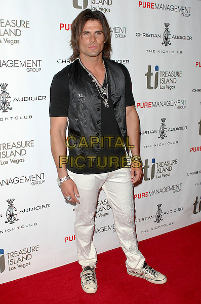JEREMY JACKSON.Designer Christian Audigier celebrates the Grand Opening of Christian Audigier the Night Club with Guest DJ Nick Cannon inside the Treasure Island (TI) Hotel and Casino, Las Vegas, Nevada, USA,  2 July 2008. .full length long hair bloodshot eye stye black waistcoat white trousers jeans shoes trainers .CAP/ADM/MJT.©MJT/Admedia/Capital Pictures