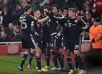 FUSSBALL  CHAMPIONS LEAGUE  ACHTELFINALE  HINSPIEL  2012/2013      FC Arsenal London - FC Bayern Muenchen       19.02.2013 Torjubel:Thomas Mueller, Dante und Toni Kroos (v.l., alle FC Bayern Muenchen)