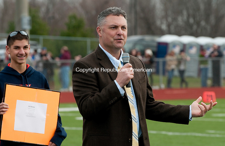 WATERTOWN, CT--- -112265JS01-Watertown's Rico Brogna addresses the crowd after being inducted into the Bob Cook Hall of Fame during halftime of the annual Thanksgiving day game between Watertown and Torrington Thursday at Watertown High School. <br /> Jim Shannon Republican-American