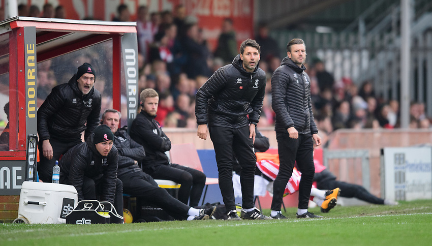 Lincoln City manager Danny Cowley, second in from right, and Lincoln City's assistant manager Nicky Cowley, right, shout instructions to their team from the technical area<br /> <br /> Photographer Chris Vaughan/CameraSport<br /> <br /> The EFL Sky Bet League Two - Lincoln City v Mansfield Town - Saturday 24th November 2018 - Sincil Bank - Lincoln<br /> <br /> World Copyright © 2018 CameraSport. All rights reserved. 43 Linden Ave. Countesthorpe. Leicester. England. LE8 5PG - Tel: +44 (0) 116 277 4147 - admin@camerasport.com - www.camerasport.com