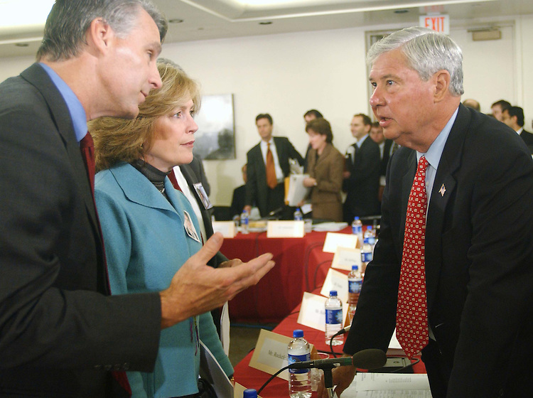 10/20/04.INTELLIGENCE REORGANIZATION--Sept. 11 Commissioner Tim Roemer and Mary Fetchet, of the commission's family task force, with Sen. Bob Graham, D-Fla., before the House-Senate conference to consider S 2845, the National Intelligence Reform Act of 2004, which would reorganize U.S. intelligence gathering and analysis operations..CONGRESSIONAL QUARTERLY PHOTO BY SCOTT J. FERRELL