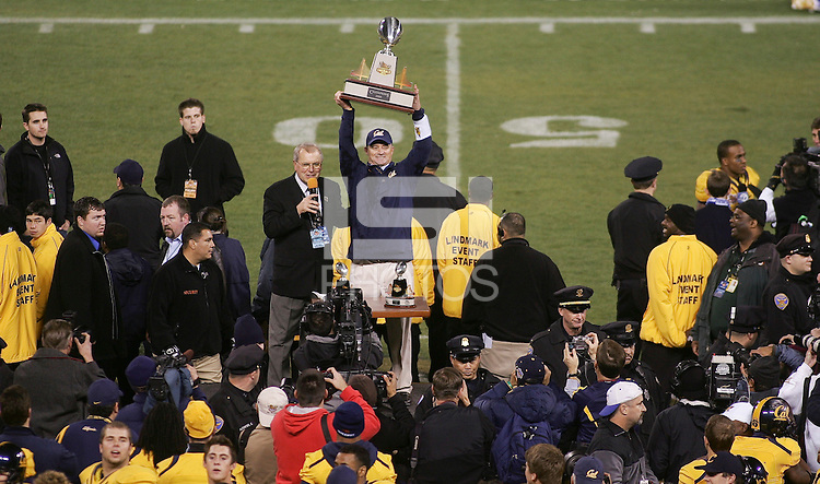Head Coach Jeff Tedford holds up the Emerald Bowl Trophy with Gary Cavalli,.2008 Emerald Bowl, San Francisco, Calif., Saturday, Dec. 27, 2008. University of California 24, University of Miami, 17.